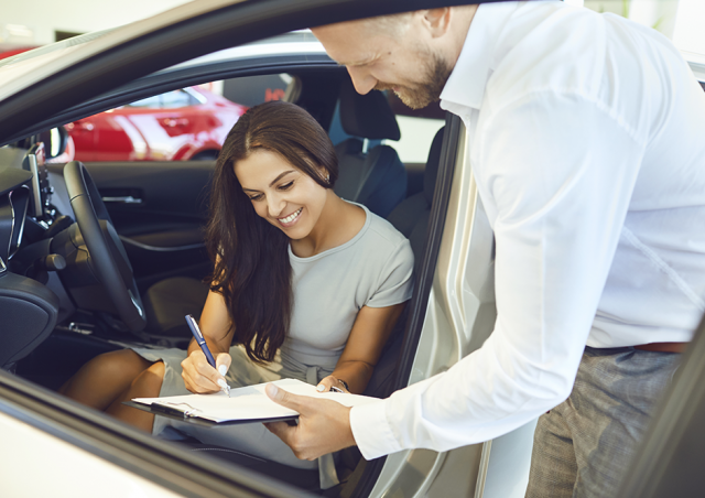 Woman Signing for Car